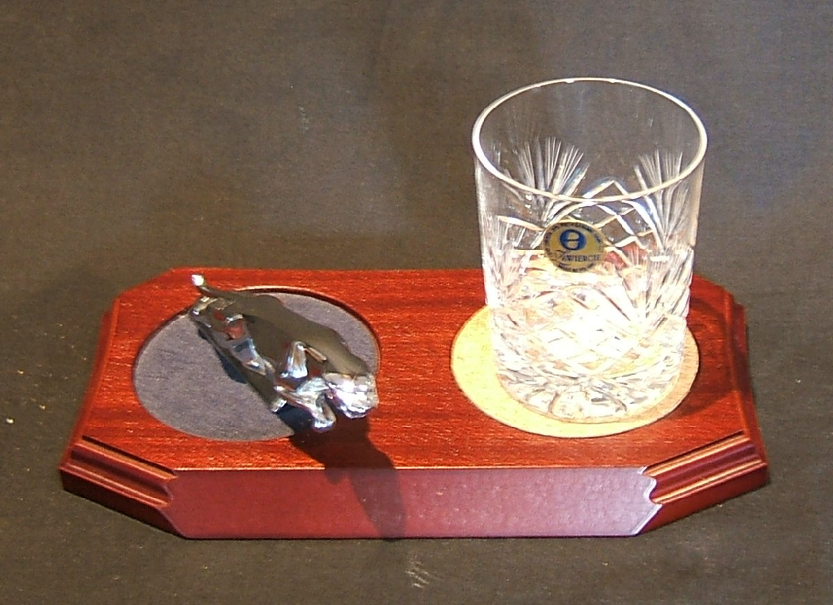 Small Chrome Plated Jaguar Mounted on a wood Plinth with One Lead Crystal Whisky Tumbler and Cork Coaster